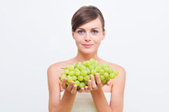 Girl with green grapes. Royalty Free Stock Image