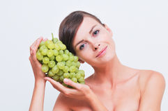 Girl with green grapes. Stock Image