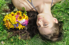 Girl on a green grass Stock Image