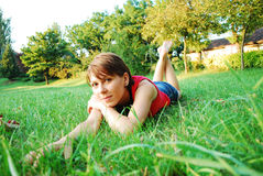 Girl in green grass Royalty Free Stock Photos