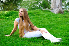 Girl on green grass Stock Images