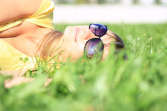 The girl on the green grass. Royalty Free Stock Photography