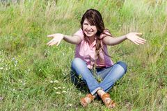 Girl at green grass. Royalty Free Stock Photo