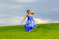 Girl on green grass Royalty Free Stock Photo