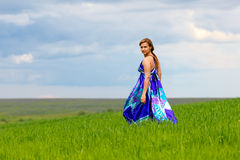 Girl on green grass Royalty Free Stock Images