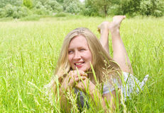 Girl on green grass Stock Photography