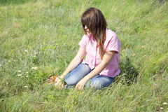 Girl at green grass at countryside. Stock Photos