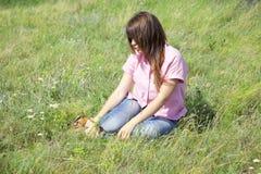 Girl at green grass at countryside. Stock Photos