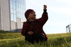 The girl on a green grass in a sunlight Royalty Free Stock Image