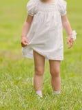 Girl on Green Grass Stock Photos