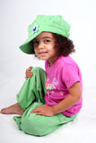 Girl in Green Hat. Close up of a young toddle girls brown eyes Royalty Free Stock Photo