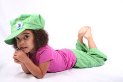 Girl in Green Hat. Close up of a young toddle girls brown eyes Royalty Free Stock Photos
