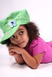 Girl in Green Hat. Close up of a young toddler girls brown eyes Stock Photography