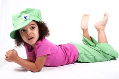 Girl in Green Hat. Close up of a young toddler girls brown eyes Royalty Free Stock Images