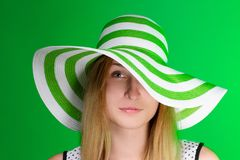 Girl in a green hat the beach strip. horizontal Royalty Free Stock Photo
