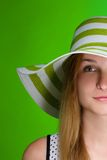 Girl in a green hat the beach strip. Vertical Stock Photography