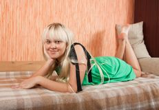 Girl in green at home royalty free stock photography