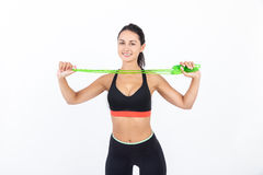 Girl with green jumping rope Stock Photos