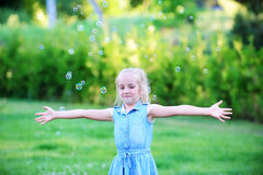 Girl on green lawn. Stock Photography