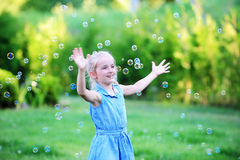Girl on green lawn. Stock Images