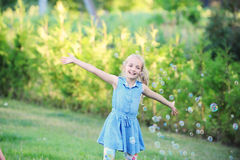 Girl on green lawn. Royalty Free Stock Photo