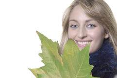 Girl with green leaves. Closeup of smiling girl with green leaves Stock Images