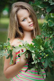 Girl in green leaves. Royalty Free Stock Photography