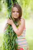 Girl in green leaves Stock Photos