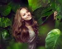 Girl in Green Mystical Forest. Beautiful Girl in Green Mystical Forest. Tropical Jungle royalty free stock photo