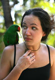 Girl with a green parrot Stock Photography