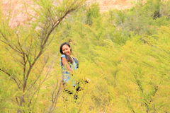 Girl among green plants Royalty Free Stock Image