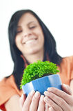 Girl with green potted Stock Photography