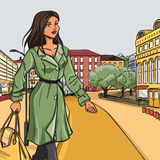 Girl in green raincoat after shopping Royalty Free Stock Image