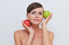 Girl with green and red apples. Royalty Free Stock Photo