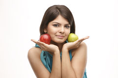 Girl with green and red apples Royalty Free Stock Photography