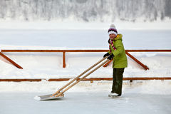 Girl in green on the rink Stock Images