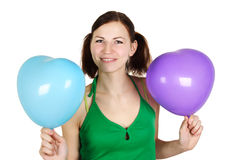 Girl in green shirt holding balloones Royalty Free Stock Images
