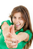 Girl in green shirt making gun gesture like handgun isolated on Stock Photography