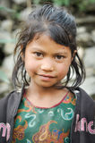 Girl in green shirt in Nepal Stock Images