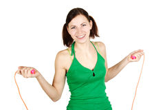Girl in green shirt with skipping rope, smiling Stock Images