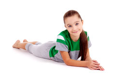 Girl in green sport's wear lying on the floor Royalty Free Stock Photos