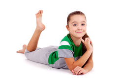 Girl in green sport's wear lying on the floor Royalty Free Stock Images