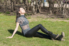 Girl on green spring grass Royalty Free Stock Photo