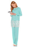 Girl in green suit with tablet computer Stock Image