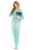 Girl in green suit with tablet computer Stock Photography