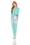 Girl in green suit with tablet computer Stock Photos