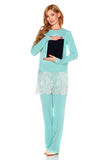 Girl in green suit with tablet computer Royalty Free Stock Image