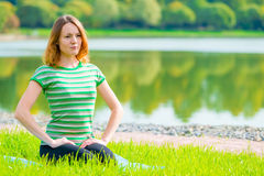 Girl in green t-shirt at the lush grass Stock Photo