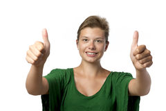 Girl in green with thumb up royalty free stock images