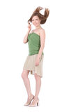 Girl  in green undershirt and beige skirt Royalty Free Stock Photo